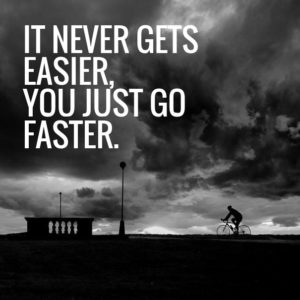 An image of a lone cyclist alongside a Greg LeMonde quote: it never gets easier, you just go faster